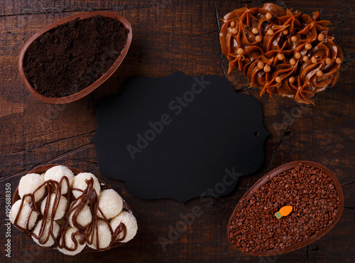 Chocolate egg with filling for Easter on wooden background