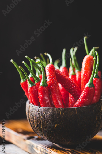 Fotobehang Hot chili peppers Red chillies on the dark background