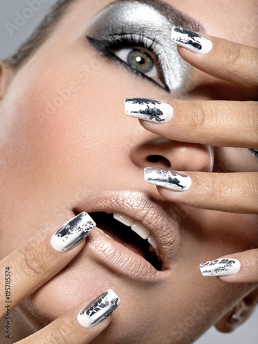 Foto op Canvas Manicure Beautiful girl with the silver makeup and nails.