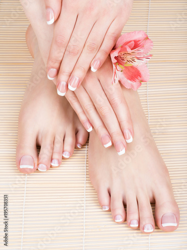 Tuinposter Pedicure female feet at spa salon on pedicure and manicure procedure