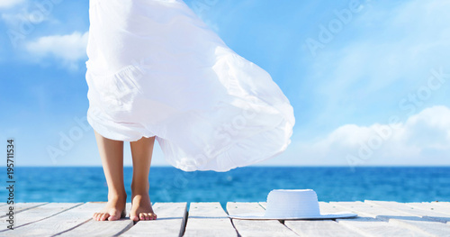 Beautiful female legs. Summer vacation concept. - 195711534