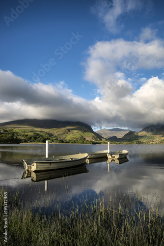 Gray traffic Landscape image of rowing boats on Llyn Nantlle in Snowdonia at sunset