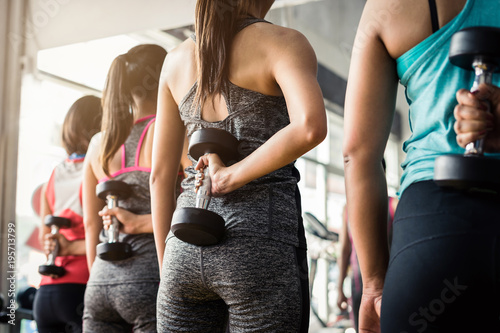 Group of woman lifting weights with dumbbells