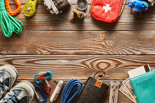 Travel items for hiking over wooden background - 195714723