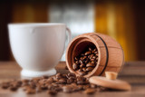 barrel and grains of coffee, focus on the barrel with coffee - 195716134