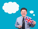 Welcome to Great Britain! Learn English! Adult man with the flag of the Kingdom of Great Britain on a blue background. Banner for advertising English language courses. - 195718537