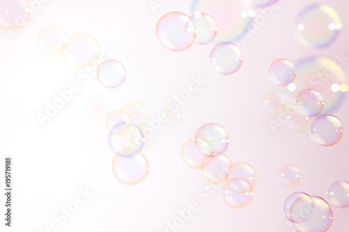 Abstract pink soap bubbles floating in the air.