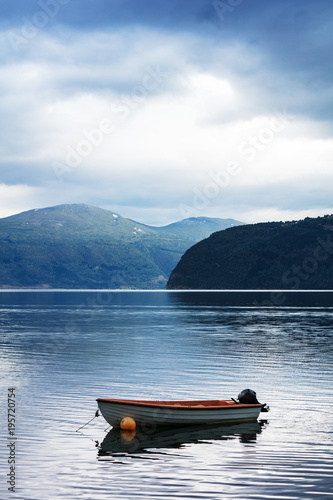 boat on water fjord with mountains in Norway - 195720754