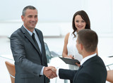closeup.handshake of business partners in the office.