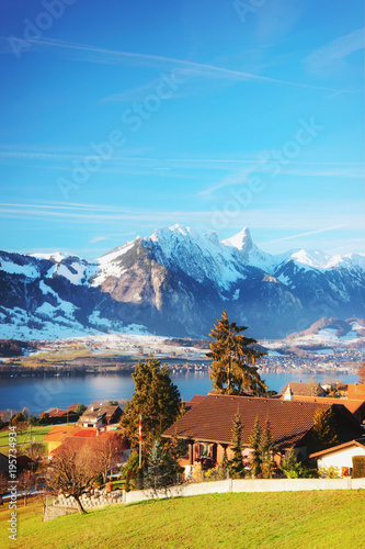 Aluminium Blauw Sigrilwil village with Swiss Alps mountains and Thun lake