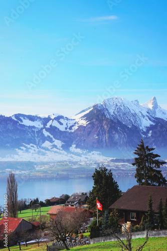Fotobehang Pool Sigrilwil village at Swiss Alpine mountains with Thun lake