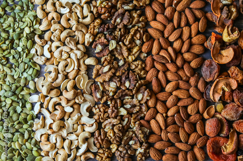 Papiers peints Café en grains pumpkin seeds, cashew, walnut, almonds, on a wooden background, background texture, view svrhu, benefits, vitamins, still life beautiful, healthy lifestyle, diet, charge for the brain, flat lay