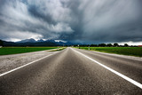Road leading into a storm - Forggensee and Schwangau, Germany Bavaria - 195742756