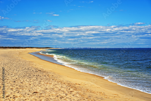 Tuinposter New York Ocean shore and view to NYC from Sandy Hook USA