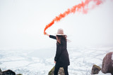 Girl with red smoke bomb. Smoke signal - 195750372