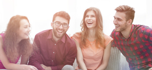 group of cheerful young people sitting on the couch.