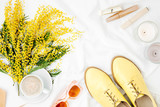 Yellow flowers, coffee cup and stylish shoes with female accessories  in bed. Flat lay, top view - 195762364