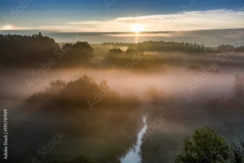 Sticker Sunrise at foggy valley in autumn, Poland