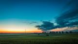 Dusk over field wind turbines in summer, Poland - 195783359