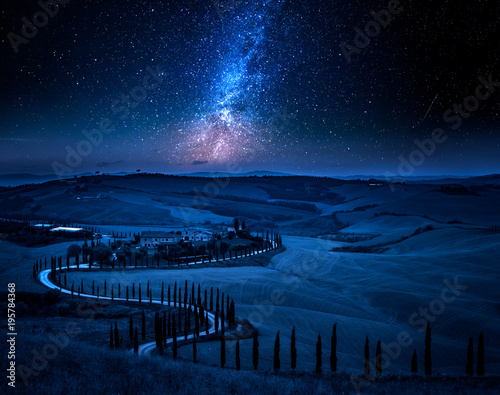 Fotobehang Toscane Milky way and winding road with cypresses, Tuscany