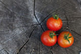Fresh tomatoes on a wooden background - 195787316
