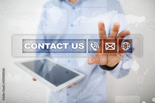 Contact us button and text on virtual screen. Business and technology concept.