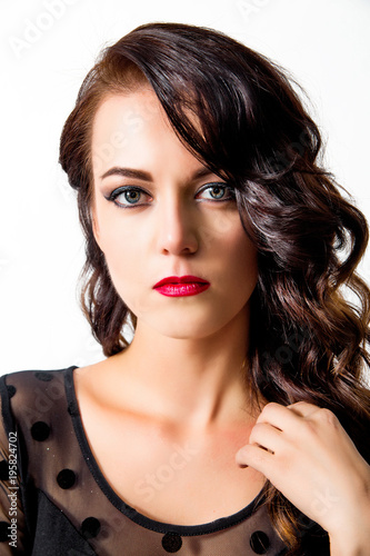 beautiful young woman with fashion make-up and hairstyle in blac © ribalka yuli