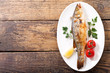 plate of baked fish with vegetables - 195827185