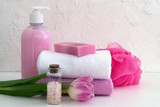 Liquid soap and two towels on a white background. - 195828705