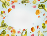 Various flying or falling summer fruits,berries and vegetables on light blue background, frame. Healthy detox food layout concept - 195830763