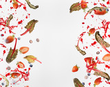 Frame of various flying or falling berries with red chard leaves and splash of juice  on white background - 195830775