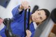 Technician flexing rubber belt