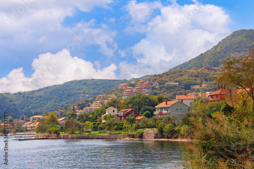 Blue sky View of small Mediterranean town of Kamenari on sunny autumn day. Montenegro, Bay of Kotor