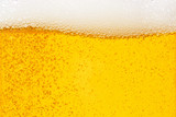 Pouring beer with bubble froth in glass for background on front view wave curve shape - 195834535