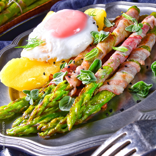 Wall mural green asparagus from the grill with egg