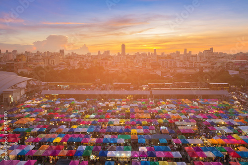 Staande foto Bangkok Top view multiple color flea market with after sunset sky background, cityscape downtown background