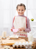 Cooking at home, girl in kitchen, making dough, healthy food concept - 195851791