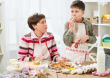 Mother and son cooking at home. Healthy food concept - 195852372