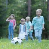 Children playing football - 195854358