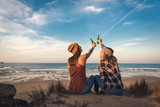 Making a toast on the beach - 195864768