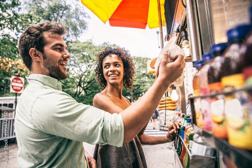 Couple at kiosk in New York