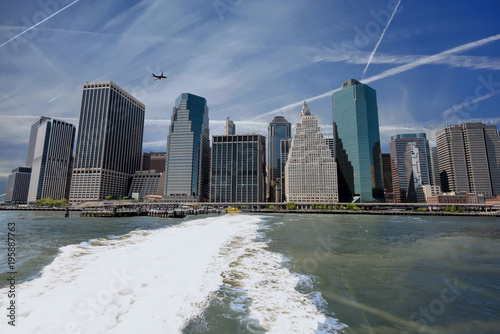 New York New York city close-up with condensation trails and plane and ferry boat wake