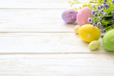 Flowers and easter eggs decoration on rustic wooden background
