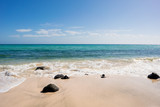 sandy beach with rocks on the shore - 195892564