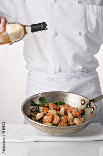 Chef Cooking Shrimp with Wine - 195893152