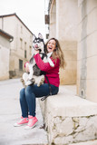 Beautiful blond woman affectionate with her pet Siberian Husky.