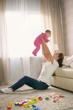 young mother plays with a baby. - 195900933