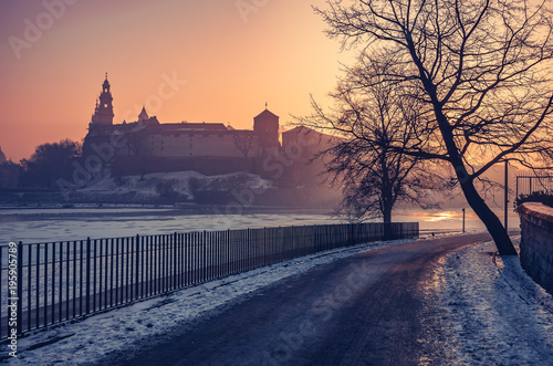 Fotobehang Krakau Krakow, Poland, Wawel Castle and Wawel cathedral in the winter over frozen Vistula river, sunrise