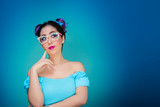 Sweet girl with glasses and blue background