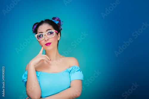 Foto op Canvas Kapsalon Sweet girl with glasses and blue background